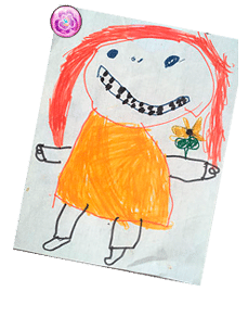 My childhood drawin of a red headed toothy grinned girl